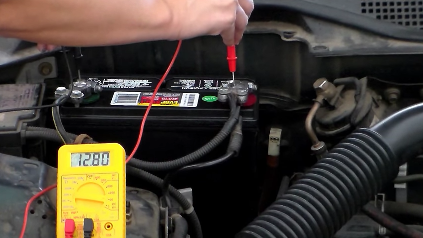 Use a voltmeter to test the open circuit voltage of the Camaro's battery.